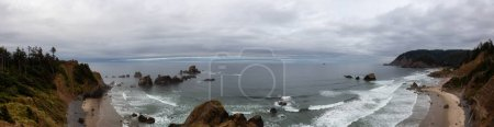 Photo for Ecola State Park, Cannon Beach, Oregon, United States. Beautiful Panoramic View of the Sandy and Rocky Beach on Pacific Ocean Coast during a cloudy summer sunrise. - Royalty Free Image