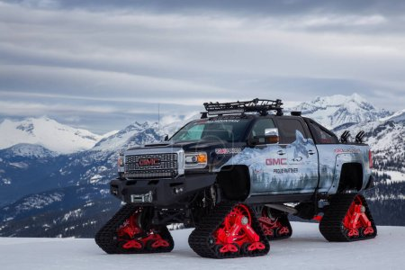 Photo pour Whistler, British Columbia, Canada - Feb 21, 2020: GMC Truck with Snow Tracks on top of a mountain during a cloudy and sunny day. - image libre de droit