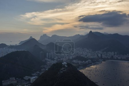 Christ the Redeemer (Cristo Redentor) and mountains, seen from the Sugar Loaf Mountain during sunset