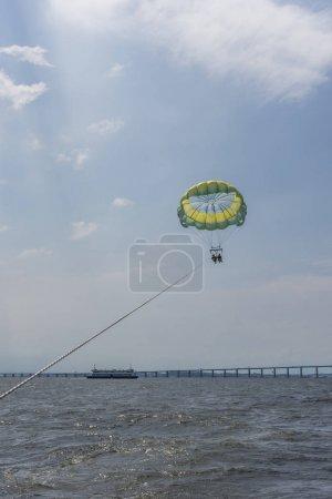 Brazil, Rio de Janeiro - March 07, 2018: Girls parasailing in Guanabara Bay