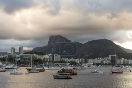 landscape with view of Corcovado Mountain and sunset clouds in Rio de Janeiro, Brazil