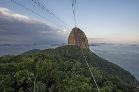 sunset landscape with cable car and mountains, seen from Sugar Loaf Mountain in Rio de Janeiro, Brazil