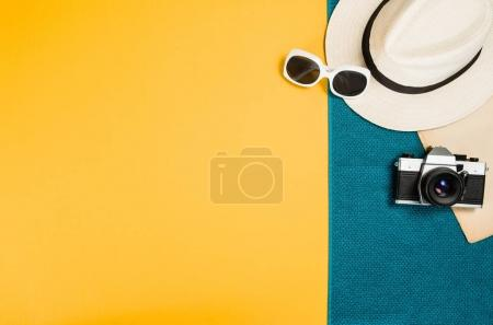 Accessories for travel top view yellow background with copy space