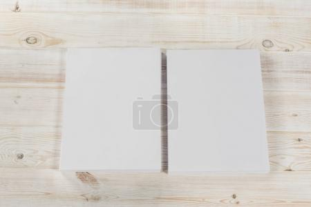 Photo for Mockup of magazine, poster, A4 brochure, catalog or flyer isolated on white wooden background. Blank page top view for use in design, mockups and simulations. - Royalty Free Image