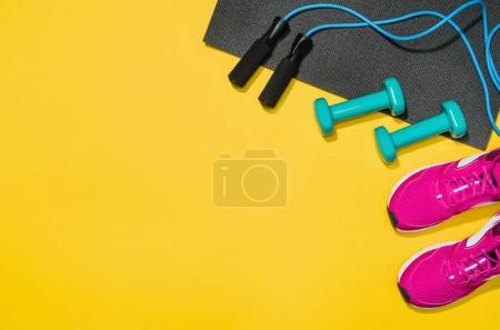 Photo for Fitness accessories, healthy and active lifestyles concept background with copy space for text. Products with vibrant, punchy pastel colours and frame composition. Image taken from above, top view. - Royalty Free Image