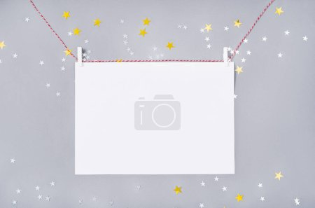 Photo for Christmas and New Year holiday background. Xmas greeting card. Christmas accessories on gray background top view. Flat lay - Royalty Free Image