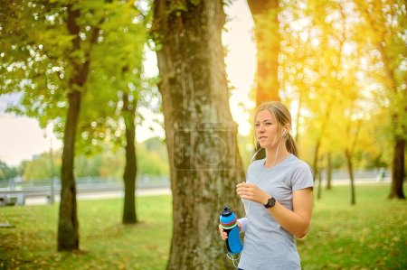 Girl athlete is training outdoors. Jogging. Health...
