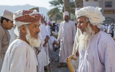 senior omani men talking at Nizwa market