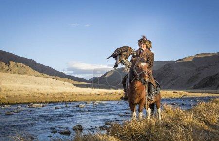 Mongolian nomad eagle hunter on his horse