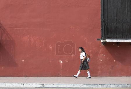 Mexican schoolgirl walking