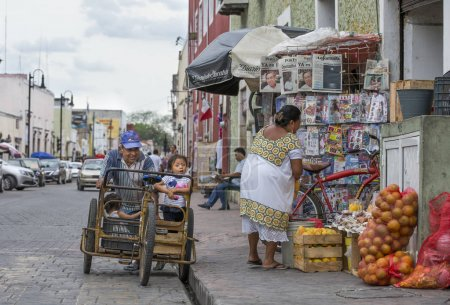 people on old mexican street at daytime