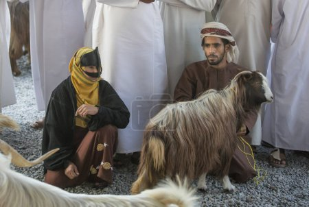 omani couple with a goat