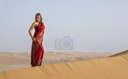 woman in a red dress in a desert
