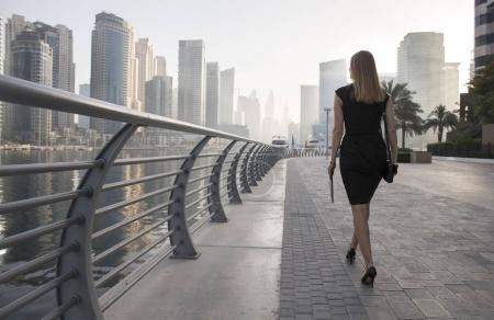 Photo for Businesswoman in a formalwear walking in Dubai Marina - Royalty Free Image