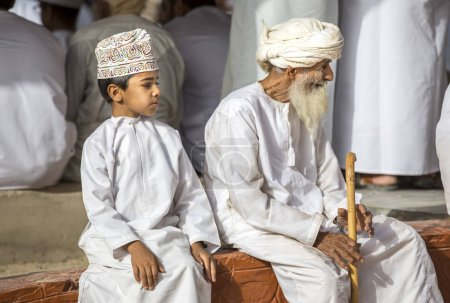 omani man and boy at market