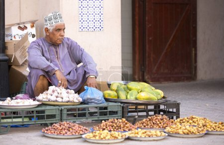 man selling dates at street market