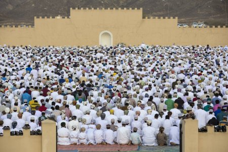 Men praying at Eid al Fitr in Nizwa