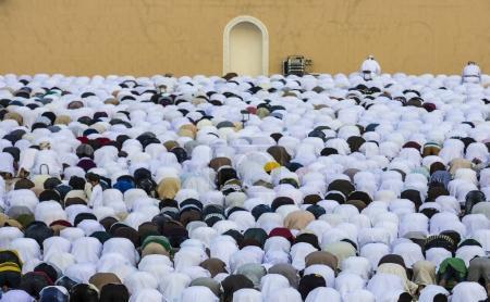 Men praying at Eid al Fitr in Nizwa
