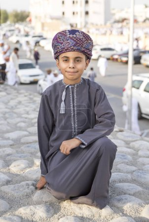 omani boy in tradtional outfitson