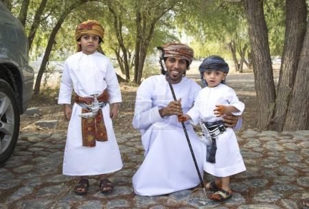 Omani man and children