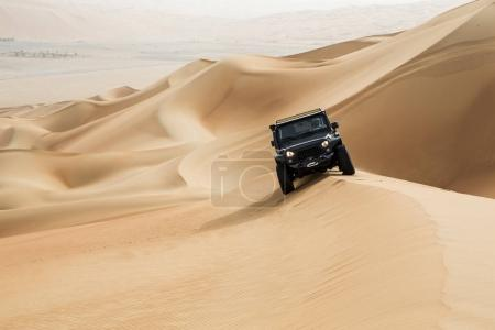 car driving in Rub al Khali Desert
