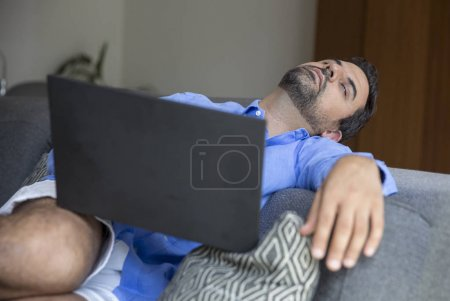 man fallen asleep while working with laptop
