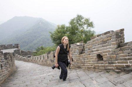 woman walking on a great wall of china