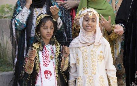 Nizwa, Oman, 10th November 2017: omani girls in traditional clothes singing songs