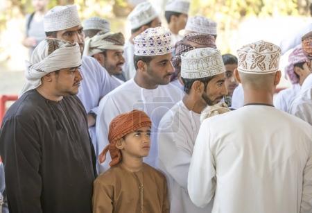 Nizwa, Oman, 10th November 2017: omani men socializing at goat market