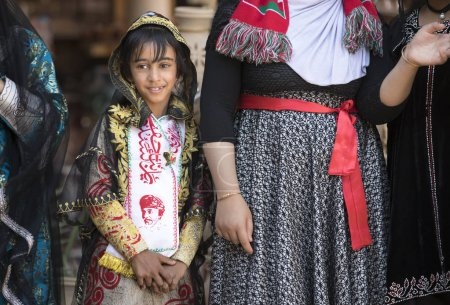 Nizwa, Oman, November 10th, 2017: omani girl dressed in traditional clothing smiling