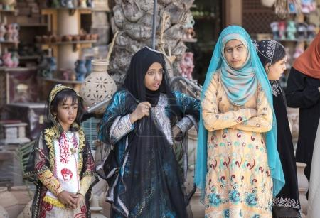 Nizwa, Oman, November 10th, 2017: omani girls dressed in traditional cloting standing in group