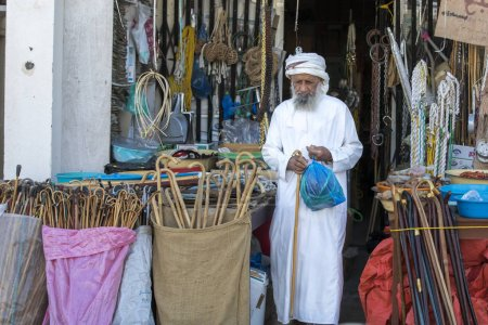 old man at a shop in Sinaw