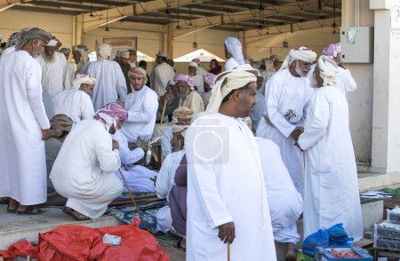 men at a market