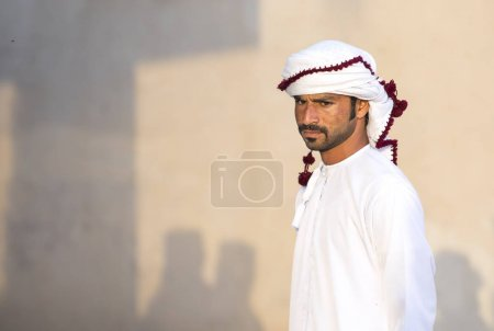 Nizwa, Oman, December 1st, 2017: young man on beige background