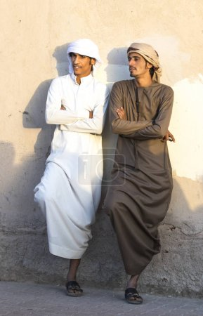 Nizwa, Oman, December 1st, 2017: young men socialising at a market