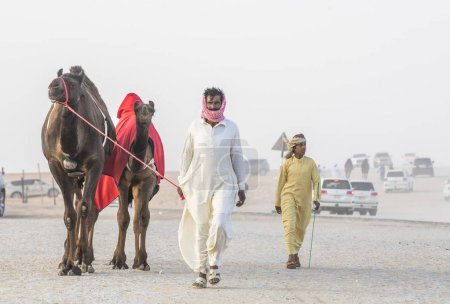 Madinat Zayed, United Arab Emirates, December 15th, 2017: arab men with his camels at The Million Street