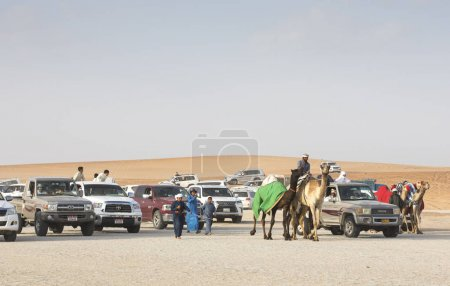 Madinat Zayed, United Arab Emirates, December 15th, 2017: arab men with camels at The Million Street
