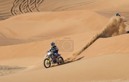 Dubai, United Arab Emirates, January 19th, 2018: two riders on dirt bikes in a desert