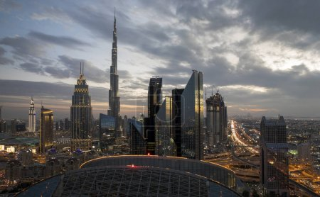 Dubai skyline at sunset, beautiful city background