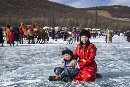 Hatgal, Mongolia, 3rd March 2018: mongolian people on a frozen lake Khuvsgul during a ice festival in winter