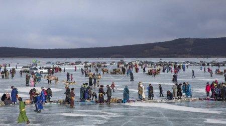 Hatgal, Mongolia - 3rd March 2018: people at festival on frozen lake Khovsgol