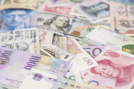 Photo pour Billets en devises internationales close up - image libre de droit