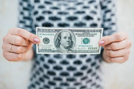 A young woman with dollars in her hands. Isolated on white background