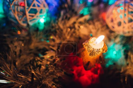 Christmas candles over dark background with lights