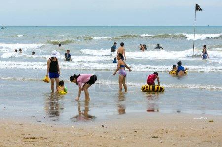 Vung Tau, Vietnam - January 29, 2018: Vietnamese families playing on the beach in Vung Tau, Vietnam.