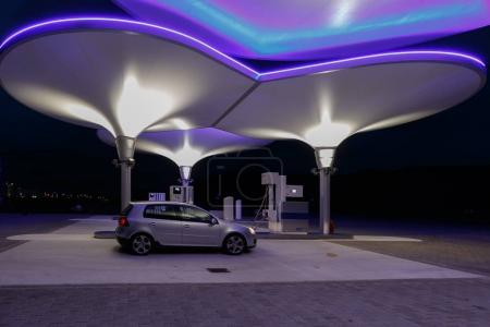 Car at futuristic gas pump