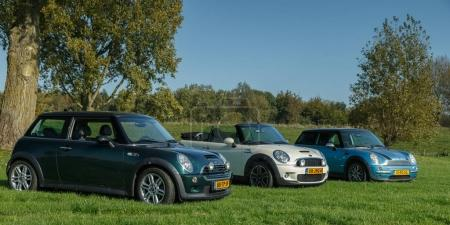 The Netherlands October 15, 2017 three types of the new Mini cars standing on grass.
