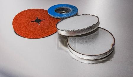discs abrasive flap wheels on metallic background.
