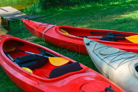 boats at the dock, red kayaks on the shore