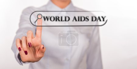 WORLD AIDS DAY written in search bar on virtual screen. 1 December concept:Human immunodeficiency virus infection:acquired immune deficiency syndrome.